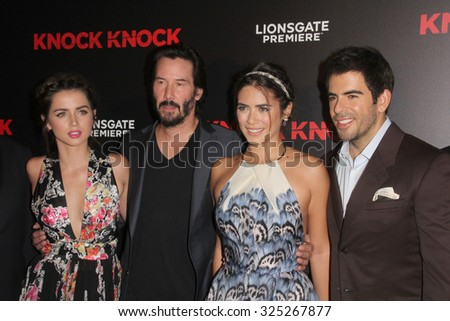 """LOS ANGELES - OCT 7:  Ana de Armas, Keanu Reeves, Lorenza Izzo, Eli Roth at the """"Knock Knock"""" Los Angeles Premiere at the TCL Chinese 6 Theaters on October 7, 2015 in Los Angeles, CA - stock photo"""