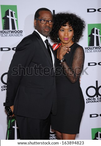 LOS ANGELES - OCT 21:  Courtney B. Vance & Angela Bassett arrives to Hollywood Film Awards Gala 2013  on October 21, 2013 in Beverly Hills, CA                 - stock photo