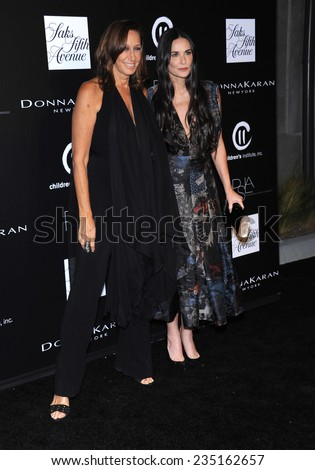LOS ANGELES - OCT 08:  Donna Karan & Demi Moore arrives to the 5th Annual PSLA Autumn Party  on October 8, 2014 in Culver City, CA                 - stock photo