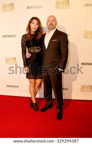 """LOS ANGELES- OCT 17: Jaime Slater and Steven DeKnight arrive at the """"Death Valley"""" film premiere Oct. 17, 2015 at Raleigh Studios in Los Angeles, CA. - stock photo"""