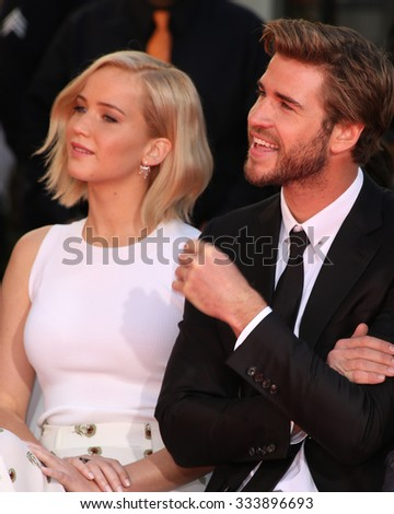 LOS ANGELES - OCT 31:  Jennifer Lawrence, Liam Hemsworth, guests at the Hunger Games Handprint and Footprint Ceremony at the TCL Chinese Theater on October 31, 2015 in Los Angeles, CA - stock photo