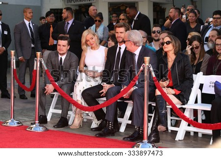 LOS ANGELES - OCT 31:  Josh Hutcherson, Jennifer Lawrence, Liam Hemsworth, guests at the Hunger Games Handprint and Footprint Ceremony at the TCL Chinese Theater on October 31, 2015 in Los Angeles, CA - stock photo