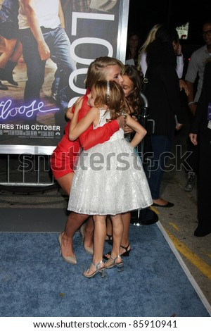 "LOS ANGELES - OCT 3:  Julianne Hough, Mary-Charles Jones (Blue Dress), Marcy Jones arriving at the ""Footloose"" Premiere at the Regency Village Theater on October 3, 2011 in Westwood, CA - stock photo"