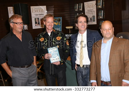 """LOS ANGELES - OCT 27:  Kevin Costner, Rick Ross, unknown at the Kevin Costner Signs """"The Explorers Guild: Volume One"""" at the Barnes and Noble on October 27, 2015 in Los Angeles, CA - stock photo"""