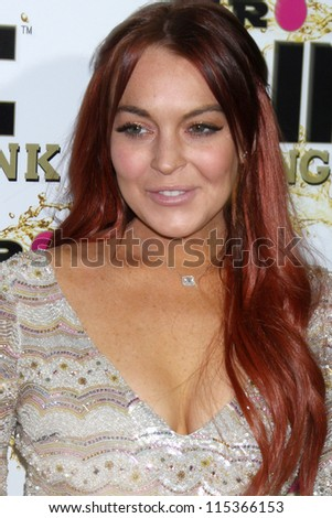 "LOS ANGELES - OCT 11:  Lindsay Lohan arrives at the ""Mr. Pink"" Energy Drink Launch at Beverly Wilshire Hotel on October 11, 2012 in Beverly Hills, CA - stock photo"