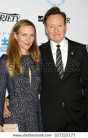 LOS ANGELES - OCT 8:  Liza Powel, Conan O'Brien at the Autism Speaks Celebrity Chef Gala at the Barker Hanger on October 8, 2015 in Santa Monica, CA - stock photo