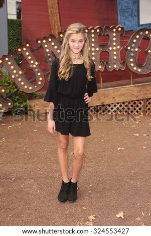 """LOS ANGELES - OCT 4:  Lizzy Greene at the """"Goosebumps"""" Los Angeles Premiere at the Village Theater on October 4, 2015 in Westwood, CA - stock photo"""