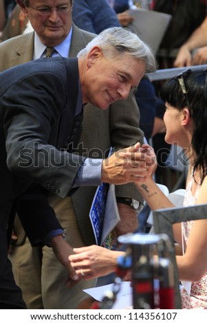 LOS ANGELES - OCT 1: Mark Harmon, Pauley Perrette at a ceremony as Mark Harmon is honored with a star on the Hollywood Walk of Fame on October 1, 2012 in Los Angeles, California - stock photo