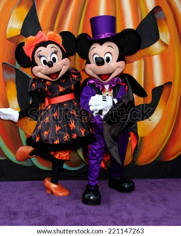 LOS ANGELES - OCT 1:  Minnie Mouse, Mickey Mouse at the VIP Disney Halloween Event at Disney Consumer Product Pop Up Store on October 1, 2014 in Glendale, CA - stock photo