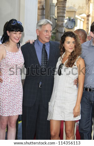 LOS ANGELES - OCT 1: Pauley Perrette, Mark Harmon, Cote De Pablo at a ceremony as Mark Harmon is honored with a star on the Hollywood Walk of Fame on October 1, 2012 in Los Angeles, California - stock photo