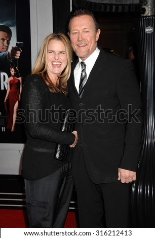 LOS ANGELES - OCT 4:  Robert Patrick and wife Barbara arrives at the Gangster Squad World Premiere  on January 7, 2013 in Hollywood, CA              - stock photo
