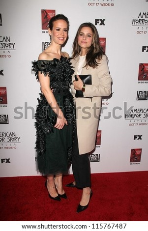 "LOS ANGELES - OCT 13:  Sarah Paulson, Amanda Peet arrives at the ""American Horror Story: Asylum"" Premiere Screening at Paramount Theater on October 13, 2012 in Los Angeles, CA - stock photo"