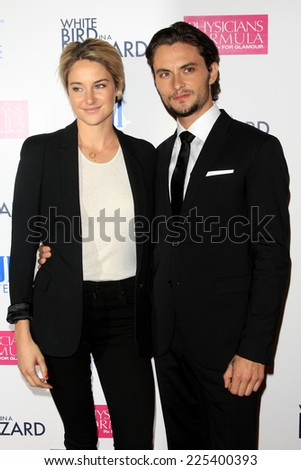 "LOS ANGELES - OCT 21:  Shailene Woodley, Shiloh Fernandez at the ""White Bird in a Blizzard"" LA Premiere at Arclight Hollywood on October 21, 2014 in Los Angeles, CA - stock photo"