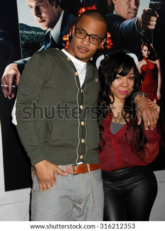 LOS ANGELES - OCT 4:  T.I. and Tameka Tiny Cottle arrives at the Gangster Squad World Premiere  on January 7, 2013 in Hollywood, CA              - stock photo
