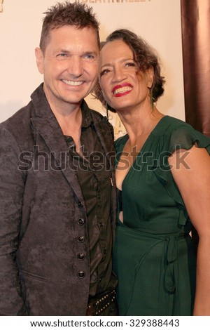 """LOS ANGELES- OCT 17: TJ Scott and Rena Owen arrive at the """"Death Valley"""" film premiere Oct. 17, 2015 at Raleigh Studios in Los Angeles, CA. - stock photo"""