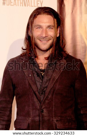 """LOS ANGELES- OCT 17: Zach McGowan arrives at the """"Death Valley"""" film premiere Oct. 17, 2015 at Raleigh Studios in Los Angeles, CA. - stock photo"""