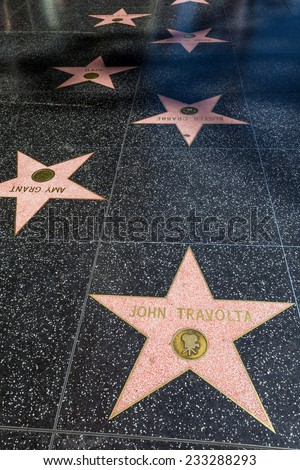 LOS ANGELES - OCTOBER 25: Hollywood Walk of Fame on October 25, 2014 in Hollywood, California. This star is located on Hollywood Blvd. and is one of 2400 celebrity stars. - stock photo
