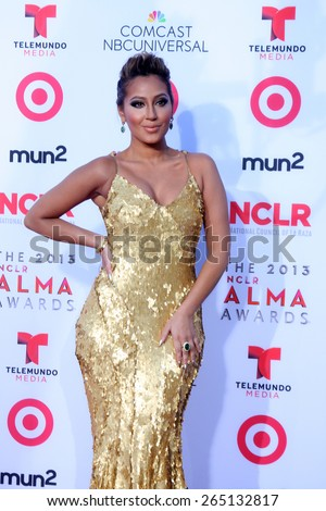 LOS ANGELES - SEP 27:  Adrienne Bailon at the 2013 ALMA Awards - Arrivals at Pasadena Civic Auditorium on September 27, 2013 in Pasadena, CA  - stock photo