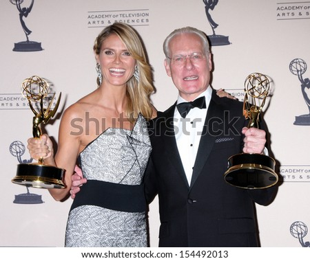 LOS ANGELES - SEP 15:  Heidi Klum, Tim Gunn at the Creative Emmys 2013 - Press Room at Nokia Theater on September 15, 2013 in Los Angeles, CA - stock photo