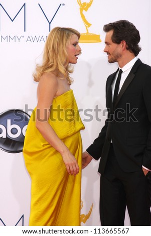 LOS ANGELES - SEP 23:  Hugh Dancy, Claire Danes arrives at the 2012 Emmy Awards at Nokia Theater on September 23, 2012 in Los Angeles, CA - stock photo