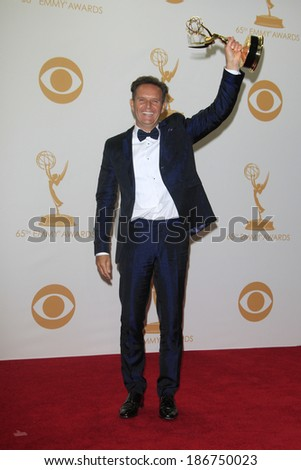 LOS ANGELES - SEP 22: Mark Burnett in the press room during the 65th Annual Primetime Emmy Awards held at Nokia Theater L.A. Live on September 22, 2013 in Los Angeles, California - stock photo