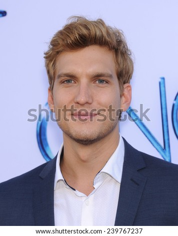 "LOS ANGELES - SEP 21:  Scott Michael Foster arrives to the ""Once Upon A Time"" Season Premiere on September 21, 2014 in Hollywood, CA                 - stock photo"