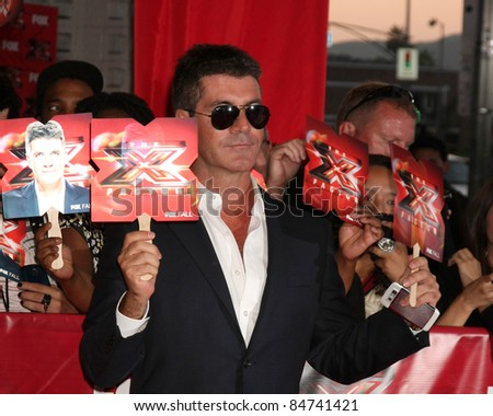 LOS ANGELES - SEP 14:  Simon Cowell arriving at the X-Factor Premiere Screening at ArcLight Theater on September 14, 2011 in Los Angeles, CA - stock photo