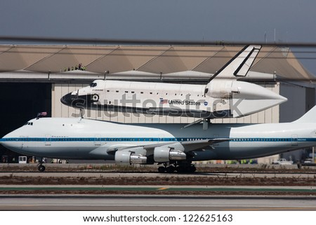 LOS ANGELES - SEPT 21: Space Shuttle Endeavour atop the Shuttle Carrier Aircraft lands in Los Angeles, Sept 21, 2012. - stock photo