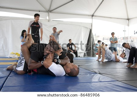 LOS ANGELES - SEPT 25:  Villa Park Jiu-Jitsu demonstrate grappling at Little Tokyo's Cherry Blossom Festival on September 25, 2011 in Los Angeles, CA. - stock photo