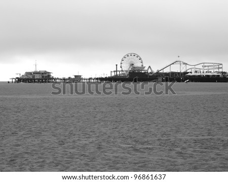 LOS ANGELES - SEPTEMBER 17: Santa Monica Pier in Los Angeles, CA on September 17, 2011.  The long, narrow Municipal Pier opened September 9, 1909. - stock photo