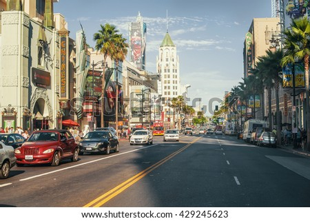 LOS ANGELES - SEPTEMBER 7, 2013: View of Hollywood Boulevard at sunset. In 1958, the Hollywood Walk of Fame was created on this street as a tribute to artists working in the entertainment industry. - stock photo