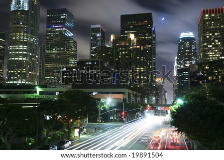 Los Angeles skyline under the moonlight - stock photo
