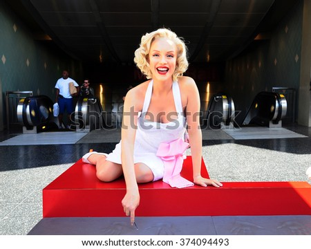 LOS ANGELES, U.S.A. - APRIL 8, 2014 : Marilyn Monroe statue on the Walk of Fame in Los Angeles. The Hollywood Walk of Fame stretches for 15 blocks of sidewalk on Hollywood Boulevard. - stock photo