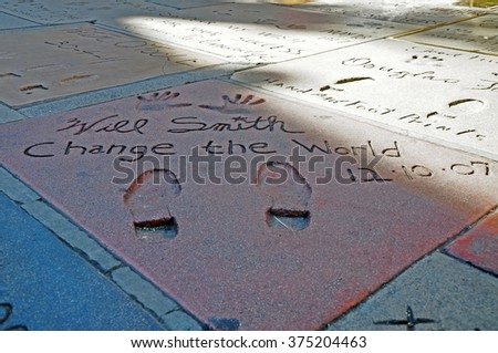 LOS ANGELES U.S.A. - APRIL 8, 2014 : Will Smith inscription outside the Chinese Theater in Hollywood. TCL Chinese Theatre is a cinema on the Hollywood Walk of Fame in Los Angeles. - stock photo