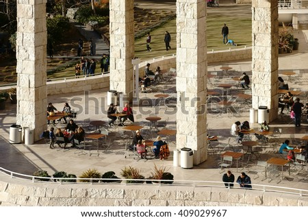 LOS ANGELES, UNITED STATES - DECEMBER 27: Museum visitors sit on an outside terrace of the Getty Center on tables and chairs in the cafe on December 27, 2015 in Los Angeles / Cafe at the Getty Center - stock photo