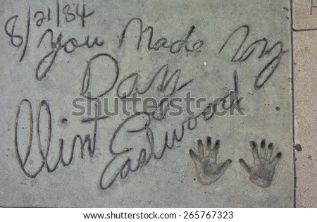 LOS ANGELES, USA - AUG 17 2013: Clint Eastwood handprints along the Walk of Fame in Los Angeles - stock photo
