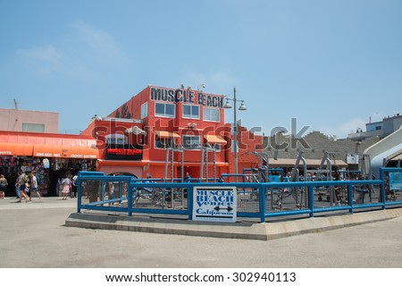 LOS ANGELES, USA - AUGUST 5, 2014 - excercise of black man in muscle beach  in venice beach  in los angeles - stock photo