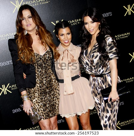 LOS ANGELES, USA - AUGUST 17: Khloe Kardashian, Kourtney Kardashian and Kim Kardashian at the Kardashian Kollection Launch Party held at the Colony in Hollywood, USA on August 17, 2011. - stock photo
