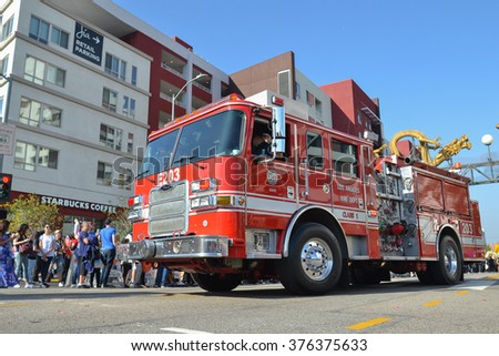 Los Angeles, USA - February 13, 2016: Fire truck during the 117th Golden Dragon Parade during the 117th Golden Dragon Parade, celebrating Chinese New Year and the Year of the Monkey. - stock photo