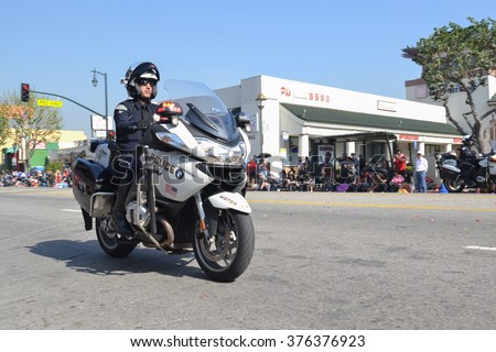Los Angeles, USA - February 13, 2016: Motorcycle Police officer  during the 117th Golden Dragon Parade, celebrating Chinese New Year and the Year of the Monkey. - stock photo