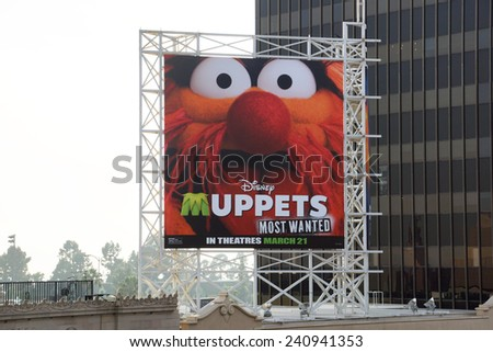 LOS ANGELES, USA - JANUARY 23, 2014: Disney Muppets Most Wanted in theatres March 21 billboard on Hollywood Boulevard featuring a photo of the character Animal. - stock photo
