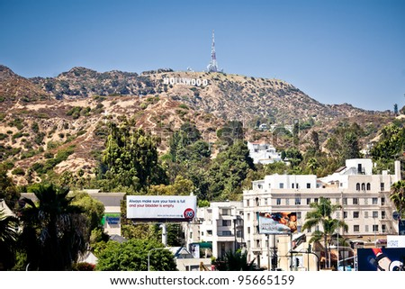 LOS ANGELES, USA - JULY 19: View of Hollywood sign on July 19, 2011 in Los Angeles, California. Sign is located in the Hollywood hills area of Mount Lee, built in 1923 - stock photo