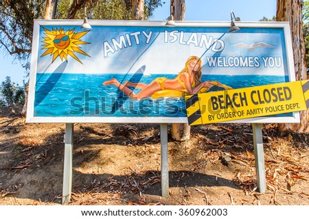 LOS ANGELES, USA - SEP 27, 2015: Beach Closed notice at the Jaws film decoration  at the Hollywood Universal Studios. Jaws is a 1975 American film directed by Steven Spielberg - stock photo