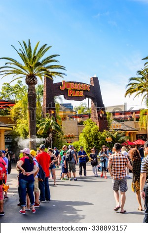 LOS ANGELES, USA - SEP 27, 2015: Entrance into the Jurassic Park area in the Universal Studios Hollywood Park. Jurassic Park is a 1993 American adventure film  by Steven Spielberg - stock photo