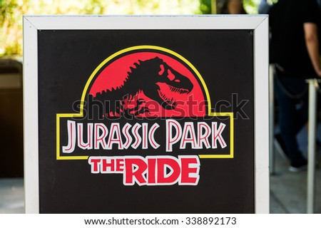 LOS ANGELES, USA - SEP 27, 2015: Jurassic Park logo in the Universal Studios Hollywood Park. Jurassic Park is a 1993 American adventure film  by Steven Spielberg - stock photo