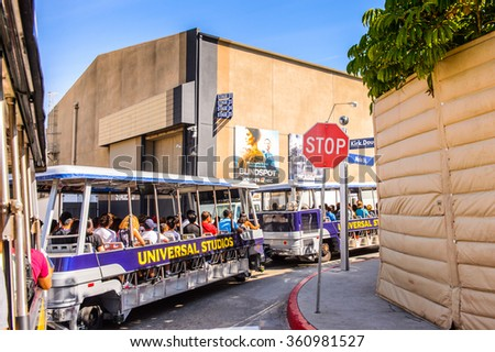 LOS ANGELES, USA - SEP 27, 2015: Tram with visitors at the the Hollywood Universal Studios. Universal Pictures company was created on June 10, 1912 - stock photo