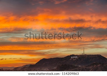 LOS ANGELES, USA-SEPTEMBER 23: Colorful sky over Hollywood Hills and the Hollywood sign at dusk on September 23, 2012 in Los Angeles. The Hollywood sign remains an iconic symbol for Los Angeles. - stock photo