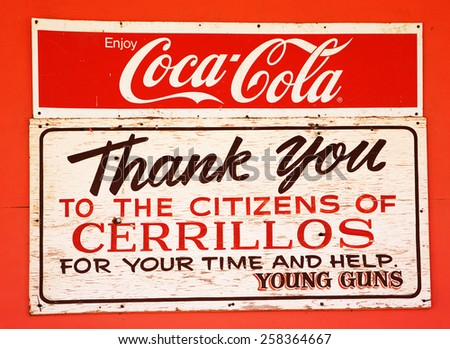 Los Cerrillos, NM, USA - February 2, 2009:  A sign above a door of a store to commemorate the use of this small town in the filming of the movie Young Guns in 1988. - stock photo