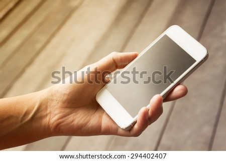 lose up of a woman using mobile smart phone,in vintage style - stock photo