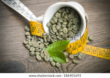 lose weight by drinking raw green coffee - stock photo